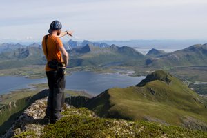 Contemplating Lofoten landscape from the summit of Haveren